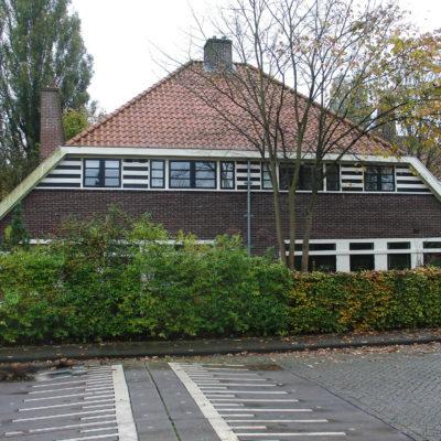 Woonhuizen in Verstrakte Amsterdamse School landelijke variant-stijl, Kometensingel 183-185